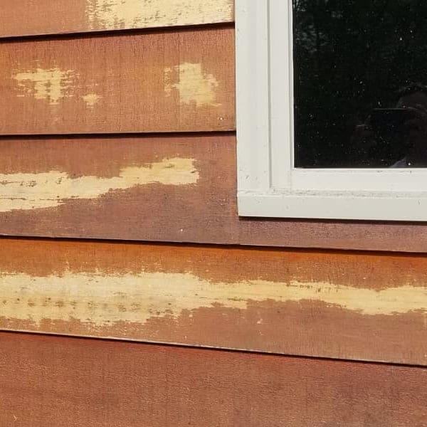 damaged cedar siding home